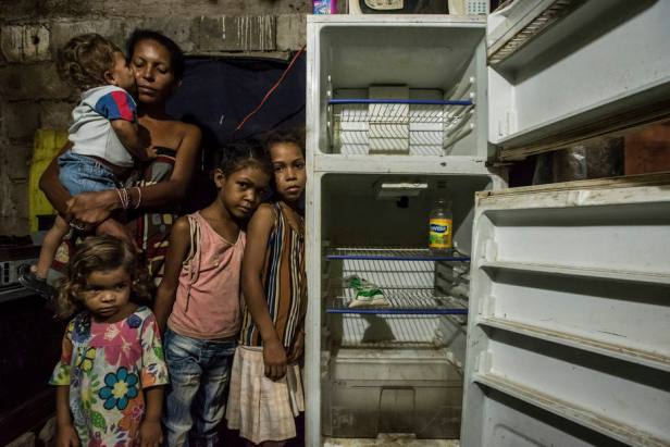 Leidy Cordova, 37, with four of her five children at their home in Cumana, Venezuela.